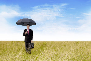 bigstock_Businessman_With_Umbrella_Shot_31408490